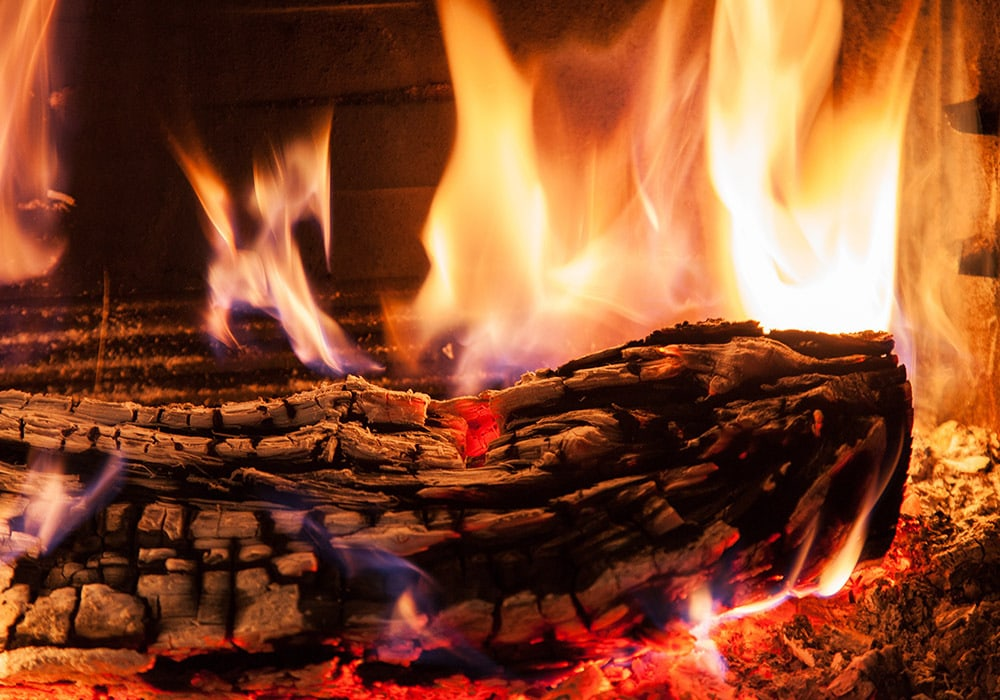 burning wood for fireplace